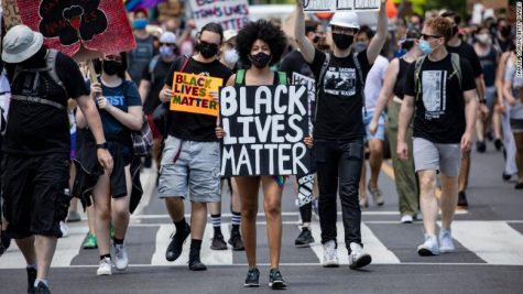 A Black Lives Matter protest in Washington D.C. marches towards the White House (Photo by Samuel Corum/Getty Images) (Courtesy of CNN)